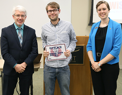 "Richard ""D.J"" Shipman, at center, with UW-Stout Provost Patrick Guilfoile and Kristen Ruka, regional associate for WiSys Technology Foundation. Shipman won the UW-Stout WiSys Quick Pitch competition May 2."