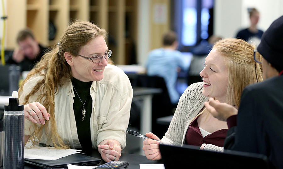 Professor Laura McCullough works with a student at UW-Stout.