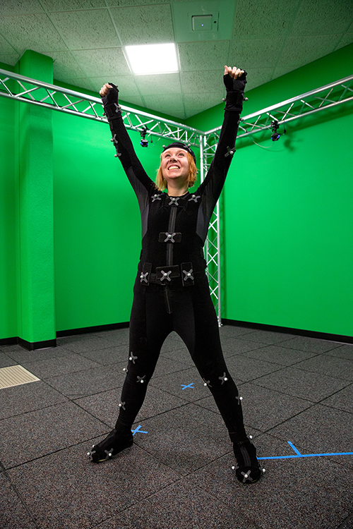 Danielle Pedersen, an entertainment design major, is surrounded by cameras as she acts in UW-Stout's motion capture studio.