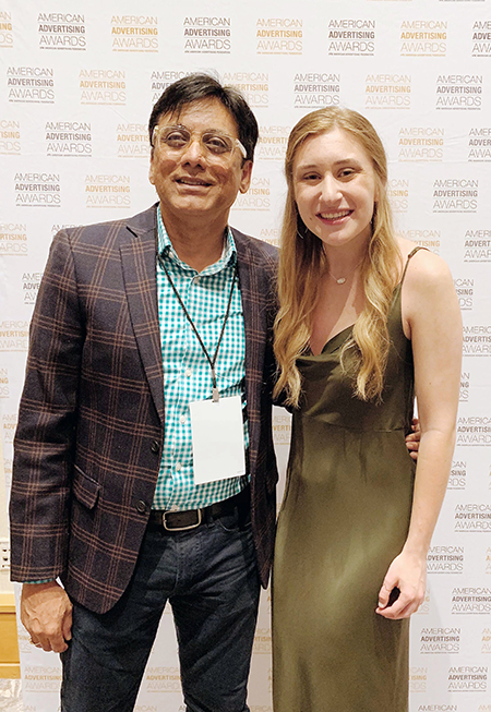 Kelsey Willaby celebrates with Professor Nagesh Shinde after receiving a silver Addy award in the student division of the American Advertising Awards in Hollywood, Fla.