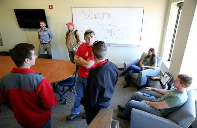 The UW-Stout Veterans Club holds an open house for the new Military and Veteran Resource Center.